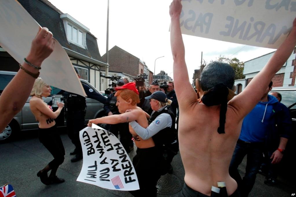 在競选和反競選活動裡,有人戴著勒龐和美國總統川普的面具