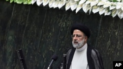 President Ebrahim Raisi delivers a speech after taking his oath as president in a ceremony at the parliament in Tehran, Iran, Aug. 5, 2021.
