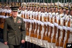 Joint Chiefs Chairman Gen. Joseph Dunford reviews a Chinese honor guard during a welcome ceremony at the Bayi Building in Beijing, Aug. 15, 2017.