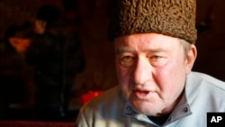 FILE - In this photo taken on Monday, Jan. 25, 2016, a Crimean Tatar leader, Ilmi Umerov, speaks during an interview to the Associated Press in Simferopol, Crimea. An international rights group has urged Russia to release Umerov who has been sent to a psychiatric hospital.
