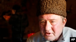 FILE - In this photo taken on Monday, Jan. 25, 2016, a Crimean Tatar leader, Ilmi Umerov, speaks during an interview with the Associated Press in Simferopol, Crimea.