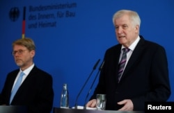 German Interior Minister Horst Seehofer (R) introduces Hans-Eckhard Sommer as new head of the Federal Office for Migration and Refugees (BAMF), in Berlin, Germany, June 20, 2018.