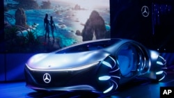 Daimler announces the world premiere of the Mercedes-Benz Vision AVTR concept car at the Daimler Keynote along with a sneak peek of the new Avatar 2 movie, background image, before the CES tech show Monday, Jan. 6, 2020, in Las Vegas. (AP Photo/Ross…