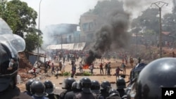 FILE - Opposition protestors clash with police in Conakry, Guinea, May 2013.