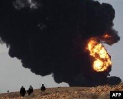 Qaddafiy g'arb hujumiga urush bilan javob qaytarishga tayyor