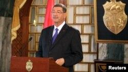 Tunisia's Prime Minister-designate Habib Essid speaks during a news conference in Tunis, Feb. 2, 2015.