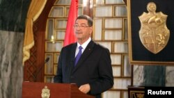 Tunisia's Prime Minister-designate Habib Essid speaks during a news conference in Tunis, Feb. 2, 2015.