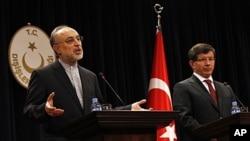 Turkey's Foreign Minister Ahmet Davutoglu, right, and Iranian counterpart Ali Akbar Salehi, Ankara, Oct. 21, 2011.
