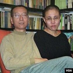 Pembangkang Tiongkok penerima Nobel Perdamaian, Liu Xiaobo bersama isterinya, Liu Xia.