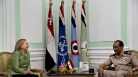 U.S. Secretary of State Hillary Rodham Clinton, left, meets with Field Marshal Hussein Tantawi, right, at the Ministry of Defense in Cairo, Egypt, July 15, 2012.