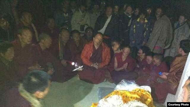 Local Tibetans gathered to pray for Kalsang Kyab after he self-immolated Tuesday.