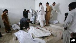 Family members and hospital staff try to identify the victims of a double suicide bombing at a morgue in Quetta September 7, 2011.