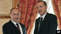 Turkish Prime Minister Recep Tayyip Erdogan, right, and Russian President Vladimir Putin shake hands at their meeting in Istanbul, Turkey, Monday, Dec. 3, 2012.