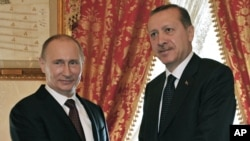 FILE - Turkish Prime Minister Recep Tayyip Erdogan, right, and Russian President Vladimir Putin shake hands, Istanbul, Dec. 3, 2012.