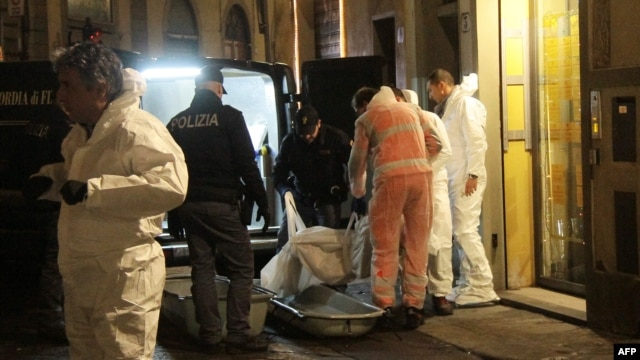 Police officers and forensics experts carry the body of Ashley Olsen, a 35-year-old American expatriate artist who was found dead in her apartment, in Florence, Italy, Jan. 9, 2016.