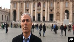 In this image taken from a video provided by Adnkronos International, Ali Agca stands in front of St. Peter's Basilica at the Vatican, Dec. 27, 2014.