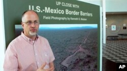 "Kenneth Madsen, an Ohio State University-Newark geography professor and border wall expert, discusses his photo exhibit of border wall pictures and maps, ""Up Close with U.S.-Mexico Border Barriers,"" in Newark, Ohio, Sept. 14, 2018."