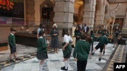 FILE - Britain's Camilla, Duchess of Cornwall talks to school children during a visit to Kelvingrove Art Gallery and Museum in Glasgow, Scotland, on Sept. 8, 2021, as the institution celebrates its 120th anniversary.