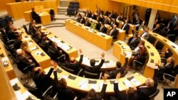Parlemen Siprus menolak proposal dana talangan yang dituntut para kreditor internasional dalam voting hari Selasa malam (19/3).