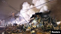 Firefighters operate at the site where a large explosion occurred at a restaurant in Sapporo, Hokkaido, northern Japan, in this photo taken by Kyodo, Dec. 16, 2018.