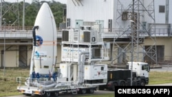 FILE - The European Space Agency's (ESA) Intermediate eXperimental Vehicle being transported ready for its launch atop a Vega rocket from Europe's Spaceport in French Guiana, Jan. 30, 2015.