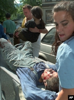 FILE - Victims of the shelling in downtown Sarajevo are brought to Kosevo Hospital in Sarajevo, August 28, 1995.