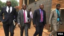 Supa Mandiwanzira appearing before a local magistrate in Harare.