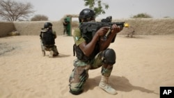 Nigerian special forces guard a compound as they participate in an hostage rescue exercise during last year's Flintlock exercise in Mao, Chad, Saturday, March 7, 2015.