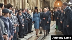 Britain's Kate, the Duchess of Cambridge, centre left, walks, as she attends a service at RAF church St Clement Danes, to mark the 75th anniversary year of the RAF Air Cadets, in London, Feb. 7, 2016.