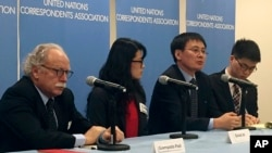 FILE - North Korean defector Jung Gwang Il, third from left, speaks to reporters at United Nations headquarters, Dec. 10, 2015, in New York, before attending a U.N. Security Council meeting on North Korea's human rights situation.