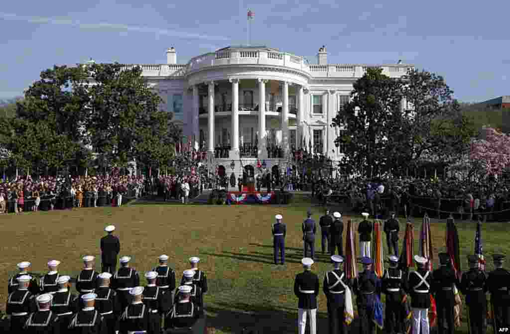 """British Prime Minister Cameron speaks during an an elaborate arrival ceremony at the White House, calling the U.S.-British alliance """"the most powerful partnership for progress"""" in the world. (AP)"""