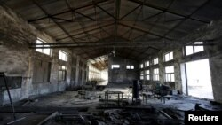 FILE - A closed brick factory building on the outskirts of Beijing, China, Jan. 18, 2016. Chinese manufacturing ebbed in January to its lowest in more than three years, a possible sign of further weakness in the world's No. 2 economy.