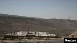 Punëtorë palestinezë duke punuar në ndërtimin e një kolonie izraelite në Bethlehem
