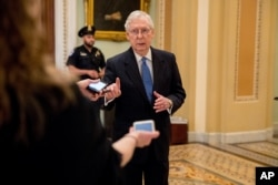 Senate Majority Leader Mitch McConnell speaks to reporters outside the Senate chamber, March 23, 2020, in Washington.