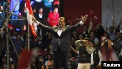 FILE - Peru's former president Alan Garcia greets supporters during a meeting in Lima, Oct. 30, 2015.