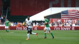 Jozy Altidore, who scored the first goal of the game, also assisted on one of Clint Dempsey's second half goals, June 2, 2013. (Photo: Parke Brewer / VOA)