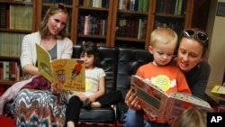 Doctors say reading aloud to children is the best way to raise life-long readers. (Jack Plunkett/AP Images)