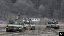 South Korean army soldiers on motorized artillery take part in this year's joint military exercises in Paju near the border with North Korea. Tensions are especially high this year because of North Korea's response to U.N. Security Council sanctions put in place because of the North's nuclear and missile tests.