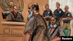 FILE - Khalid al-Fawwaz is seen with fellow terror suspect Adel Abdul Bary, seated, in this sketch made during an appearance in Manhattan Federal Court in New York, Oct. 6, 2012.