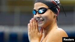 Perenang tim pengungsi Suriah, Yusra Mardini, 18, berlatih di kolam Olimpiade di Rio de Janeiro, Brazil, Januari 2016.