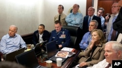 FILE - President Barack Obama and Vice President Joe Biden, along with with members of the national security team, receive an update on the mission against Osama bin Laden in the Situation Room of the White House, May 1, 2011. (AP/The White House)