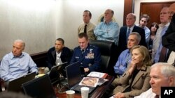 President Barack Obama and Vice President Joe Biden, along with national security team members, receive updates on the mission against Osama bin Laden, White House Situation Room, May 1, 2011. (AP/The White House)