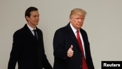 U.S. President Donald Trump gives a thumbs-up as he and White House Senior Advisor Jared Kushner depart the White House in Washington, March 15, 2017.