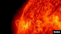 NASA's Solar Dynamics Observatory captured this image of the X1.2 class solar flare on May 14, 2013. The image show light with a wavelength of 304 angstroms. Credit: NASA/SDO