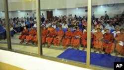 Buddhist monks and other people sit at the Extraordinary Chambers in the Courts of Cambodia (ECCC) on the outskirts of Phnom Penh, file photo.