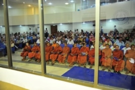 Buddhist monks and other people sit at the Extraordinary Chambers in the Courts of Cambodia (ECCC) on the outskirts of Phnom Penh, June 27, 2011.