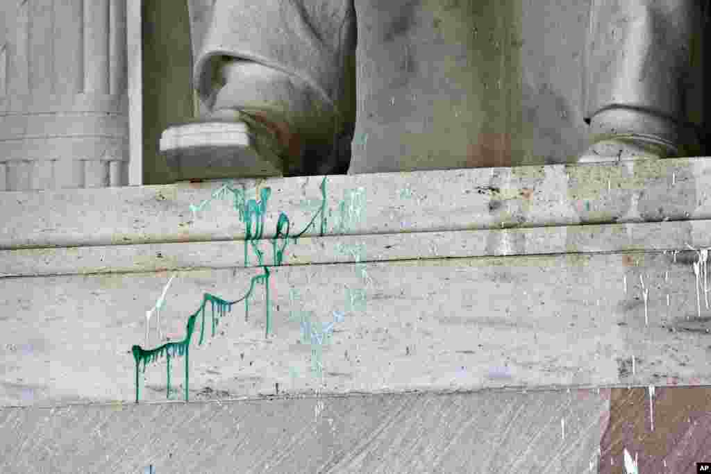 Green paint is splattered on the base of the statue of Abraham Lincoln at the Lincoln Memorial in Washington, July 26, 2013.