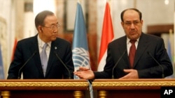 Iraqi Prime Minister Nouri al-Maliki, right, and United Nations Secretary-General Ban Ki-moon, left, during a news conference in Baghdad, Jan. 13, 2014.