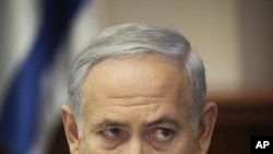 Israeli Prime Minister Benjamin Netanyahu talks during a weekly cabinet meeting in Jerusalem, Sunday, Sept. 18, 2011