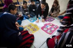 "Children playing games organized as part of the ""Syria in my Mind"" project, which was set up by an NGO named Biladi, Dec. 3, 2015. (J. Owens/VOA)"